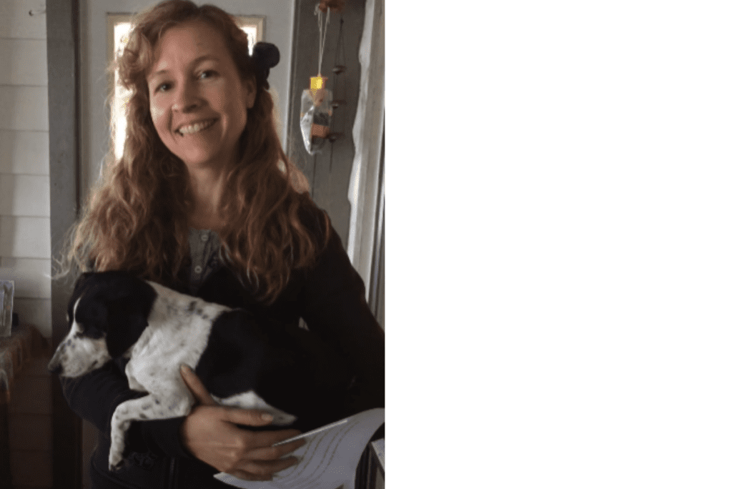 Kathleen with a rescued dog who had been abused named Lily