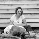 ali carrington sitting with her dog