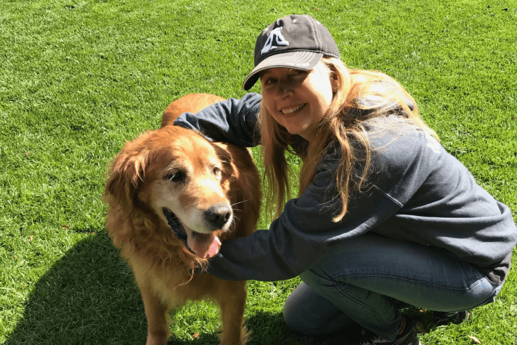 kathleen prasad with a golden retriever from lily's legacy senior dog sanctuary